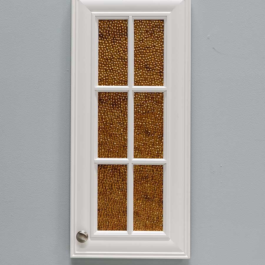 Cabinet Door with Fasade Hammered in Antique Bronze
